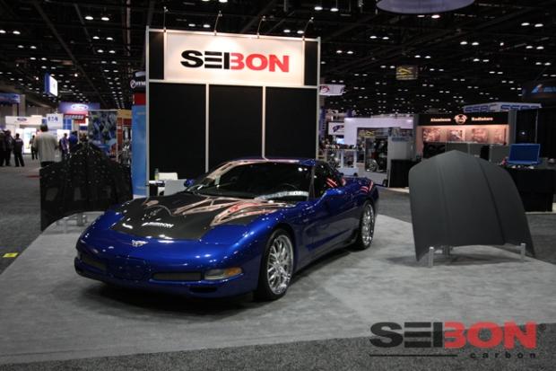 (Left to right: Pontiac Trans Am OEM hood, Chevy Corvette C5 OEM hood, and Chevy Camaro OEM dry carbon hood.)
