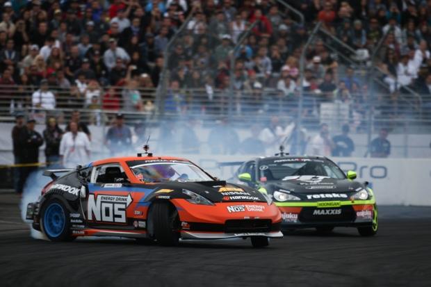 Seibon Carbon drivers Chris Forsberg [Nissan 370Z] and Ryan Tuerck [Scion FRS] battle it out at Top 8. Photo credit: Formuladrift.com