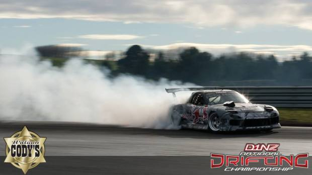 (Seibon Carbon driver Mad Mike Whiddett during the final round Cody's D1NZ National Drifting Championship Series. His Mazda RX7 is running Seibon Carbon doors, hood, and hatch. Photo credit: D1NZ.com)