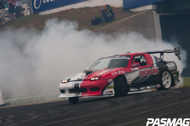 Joon Maeng's Formula Drift Nissan S13 is running a Seibon Carbon hood and hatch.