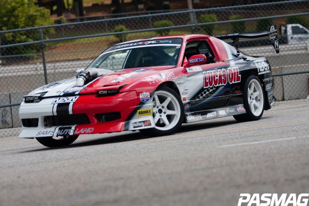 Joon Maeng's Formula Drift Nissan S13 is running a Seibon Carbon hood amd hatch.