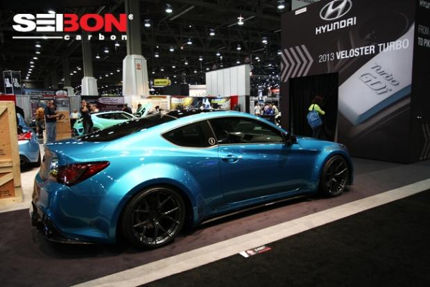 Hyundai Genesis in Hyundai booth running Seibon Carbon side skirts and rear lip.