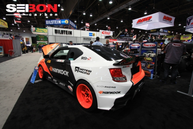 Fredric Aasbo's Formula Drift Scion tC running a Seibon Carbon set of doors and hatch.
