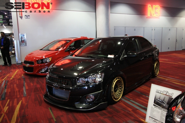 Import Tuner Chevy Sonic running a Seibon Carbon CW-style hood and SS-style front lip.