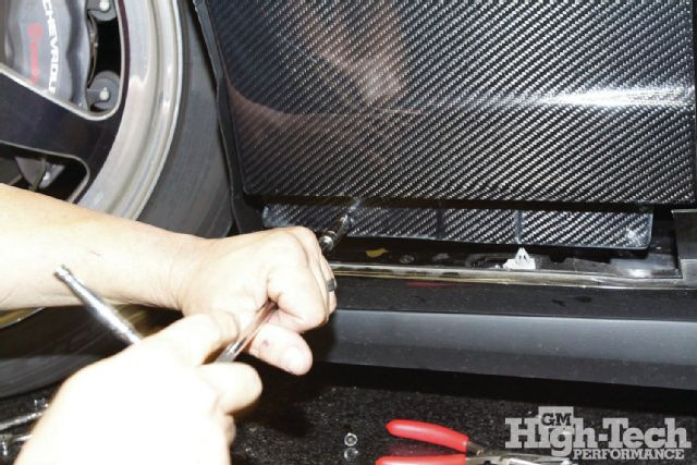 2012-chevrolet-camaro-ss-tighten-headlight-side-hardware