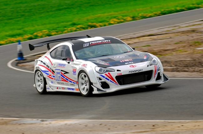 Fensport's Scion FRS runs a Seibon Carbon TS-style hood and OEM-style trunk. Photo credit: Fensport.